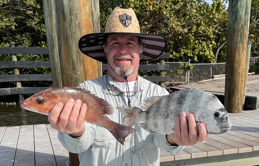 My dad with a snapper and a sheepshead